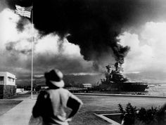 American ships burn during the Japanese attack on Pearl Harbor. (Photo by Associated Press)