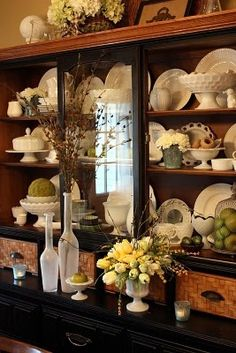 hutch - like the darker tones of the shelves - makes the cream dishware pop. also love green accents.