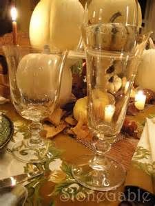 Fall wedding decor: white pumpkins, crystal everything, lace, leaves, and Amber lighting...but still keeping it white at the same time