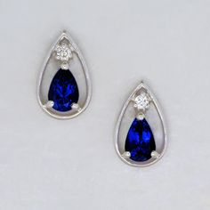 Tanzanite and Diamond Earrings. A delightful pair of pear shaped stud earrings featuring a pair of extremely fine deeply saturated blue pear shaped Tanzanites and a shimmering Diamond brilliant for that little extra sparkle. Rare Gemstones, Loose Gemstones, Natural Gemstones, Tanzanite Earrings, Diamond Earrings, Stud Earrings, Designer Earrings, Pear Shaped, Gemstone Jewelry