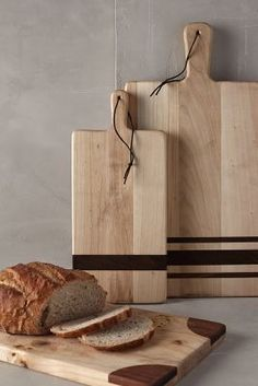 Gourmandise Bread Board - A prime resting place for glasses of wine and fresh baked baguettes, this leather-latched board is handcrafted from wooden remnants of European buildings.