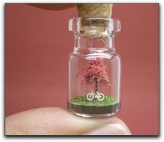 Tiny little sculpture in a bottle. Amazing!