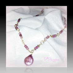 Wire wrapped pink tourmaline necklace.