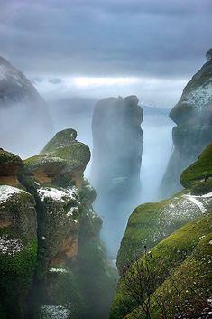 """Winter in Meteora"" by Hercules Milas   Redbubble Long Hoodie, Hercules, Travel Bags, Chiffon Tops, Greece, Island, Landscape, Winter, Outdoor"