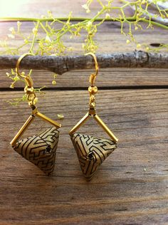 triangle-origami-earrings - by Renata Mayumi - she folds small squares and rectangles of decorative paper to make modern jewelry.