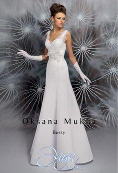Cвадебное платье Бесси: фасон годе (русалка, рыбка, трампет), длинное платье, с V-образный вырезом, с непышной юбкой, без шлейфа, модель до 2016 года, без рукавов, платье, в ограниченном количестве, широкие бретельки, основная ткань: кружево, атлас