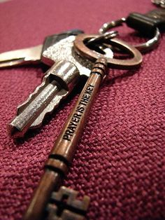 I love this! Would put it on my key ring in a heartbeat. I just love old keys, and the inscription is beautiful.