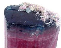 Elbaite is a mineral species belonging to the six member ring cyclosilicate tourmaline group.  Elbaite Blue Cap Tourmaline from San Diego, California