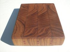 Items similar to Golden Teak wood end grain cutting board with Blood wood plugs on Etsy