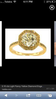 Hexagonal honey coloured yellow diamond in gold setting. I heart this