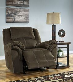 The Rocker Recliner presents the gift of comfort and relaxation. Sit back, sip hot chocolate, and indulge in all your favorite classic holiday films. Quinnlyn - Coffee - Rocker Recliner   9570125   Recliners   Roadside Furniture