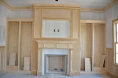 interior of hidden paneling to hide tv behind doors above a fireplace    Gallery | Mary Ross Custom Homes, LLC