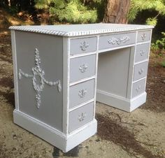Shabby French chic desk!  All sides feature my appliqués which makes this desks placement anywhere in the room, even in the center of the room!  Painted a cottage white chalkpaint,then accented with a greyish taupe chalkpaint, distressed just ...