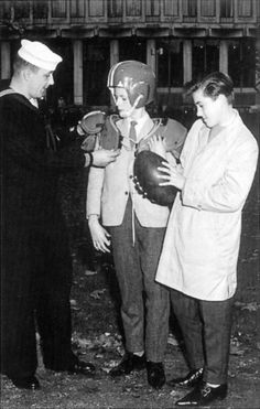 David Bowie with George Underwood and captain of US Navy rugby team Stan Lucas, 1960