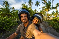 Selfie of smiling couple on quad motorcycle in Taipu de Fora beach during sunset, South Bahia near Barra Grande, Brazil