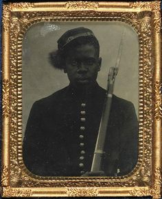"""This image, which shows a black man from the waist up, dressed in a button-down cap and holding a rifle against his left shoulder, is undoubtedly of a Union soldier.     An estimated 180,000 black soldiers served in the Union Army—10 percent of its total soldiers and 13 percent of the black population. """"We know that so many of those soldiers were very young, quite ordinary, probably farmers, possibly illiterate, but we don't know anything about him,"""" says Gates-Moresi."""