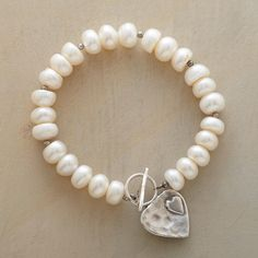 """LUV U BRACELET -- A heart-within-a-heart reaches out from the sterling silver toggle clasp on our bracelet of cultured freshwater pearls. A handcrafted exclusive. Approx. 7-1/4""""L."""