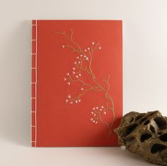 Embroidered Notebook / Blooming Branch / Red, via Etsy.