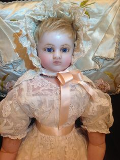 BEAUTIFUL Phoebe, a 22 inch portrait faced poured wax girl doll in stunning lace dress