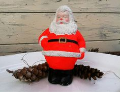 Check out this item in my Etsy shop https://www.etsy.com/listing/257227979/mid-century-bright-red-chalkware-santa