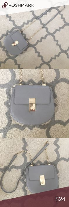 Express purse Mint condition! Gray, express purse. Gold accents. Express Bags Crossbody Bags