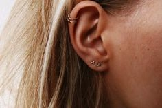 Tiny Dot Sterling Silver Stud Earrings - Eco Friendly Recycled Sterling Silver This delicate pair of studs is perfect for everyday wear in any piercing position up the ear because of their size. Theyre made from eco friendly sterling silver or eco gold and made using eco friendly