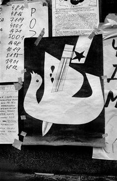 by Josef Koudelka - CZECHOSLOVAKIA. Prague. August 1968. Warsaw Pact troops invasion. Poster in a window with a dove stacked through its middle.
