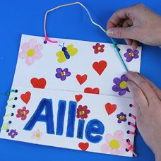 Lace the sides of a pocket to make a personalized mailbox for students for Valentines Day or everyday