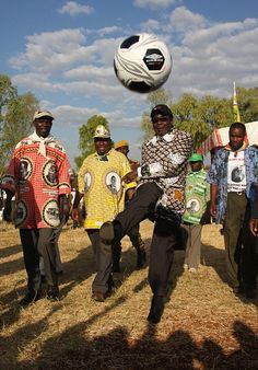 Robert Mugabe and friends model some finely tailored Robert Mugabe print shirts, 2008. These are a bit of an election year trademark