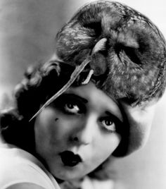 clara bow and her owl eating a mousehat - I sincerely hope this bird wasn't destroyed just to make this stupid hat!