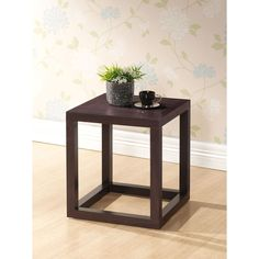 Add that special touch to your bedroom decor with this sleek and modern wooden nightstand from Hallis Modern. Finished with a dark-brown faux-wood grain, this stand works well with contemporary, transitional, and casual decors as well.