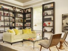 Lining a living room in bookshelves adds a cozy library feel. Start looking at typical office furniture with new eyes and continue that mindframe from room to room. It will help you switch things up around your house up and keep things fresh. Best of all, it will save you money.