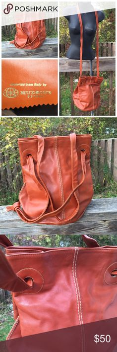 """Vintage Hudson boho leather bag cross body large Gorgeous Burt orange/brown shiny vintage leather bag. The best thing about this bag is the long strap that can be used as a cross body or pull together (slide strap on both side) to become a shoulder bag, no painful adjusting just one pull and done. It is in beautiful condition measuring, height 12"""" approximately 9"""" wide and 9.5"""" deep. Straps as shoulder bag  has a 14"""" drop as Cross Body a 29"""" drop. Vintage Bags Crossbody Bags"""