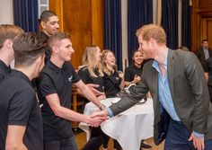 Prince Harry Photos Photos - Prince Harry Meets Coach Core Graduates during an official visit to Full Effect