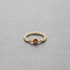 MOUNT LAVINIA HAZONITE GARNET CHAIN RING GOLD // Matt-finished gold-plated sterling silver chain ring featuring a facetted hessonite garnet. // This discreet chain ring is so easy to fall in love with – and you'll know why once you wear it. You'll forget it's even there – that is, until you start receiving compliments of course. Wear this ring alone or combine it with another piece from the Mount Lavinia collection. // shop.kinsfo.lk