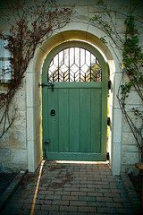 Green with metal arched window. Maybe someone could make a simple window for us... if they weld...