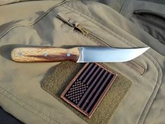 "RedEyedJack Custom Knives Turkish Hunter. 1/8"" American made file steel. 4.5"" Full flat ground turkish style clip point blade. 8.5"" overall. Walnut handle scales. Nickle silver pins. Black Kydex sheath. SOLD. $75.00 Handmade in U.S.A. Find us on Facebook REJck RedEyedJack custom knives of Bonifay, Florida E-mail redeyedjackcustomknives@yahoo.com"