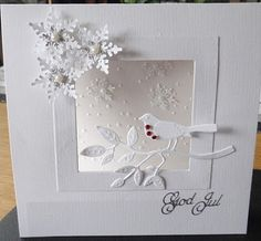 all white card with die cut snowflakes,bird and tree limb...like th framing and the way tree limb is placed over the corner of the open frame...