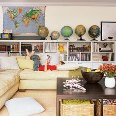 What a great family room. Love the map and vintage globes.