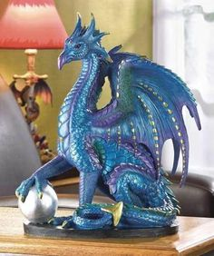 bedazzled blue dragon figurine