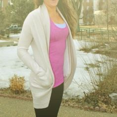 Lululemon Transformation Wrap in Heather Dune zero This incredible lulu piece is reversible with pockets and thumb holes, soft, cozy and stylish. The heathered dune color is absolutely gorgeous & flattering on any skin tone. Features a beautiful back with adjustable drawstring that allows for a shorter style or lengthen into a long, flowy cardigan. Truly a must-have sweater for casual brunch, yoga, home or out on the town, through fall & winter & into spring. Worn only once or twice. Snag…
