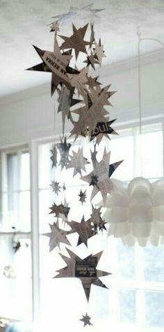 Cut oyt different size stars in different types of paper and string up at different levels - easy