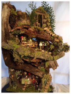 Morning Song continues to evolve into a true Fairy Castle! We've been adding details to this signature Fairy House from Fairy Tree Houses, Fairy Garden Houses, Fairy Gardens, Fir Tree, Drying Herbs, How To Make Bed, House In The Woods, Fairy Lights, Garden Design