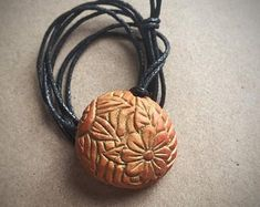 Excited to share the latest addition to my shop: Carved avocado pit necklace. Avocado Art, Avocado Seed, Chip Carving, Wood Carving, Cat Jewelry, Jewlery, Nature Crafts, Green Aventurine, Unique Necklaces