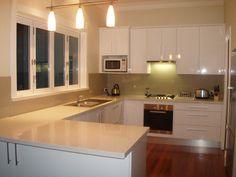 glass splashback going around window Kitchen Reno, New Kitchen, Kitchen Cabinets, Kitchen Ideas, Kitchen Designs, Kitchen Pendant Lighting, Kitchen Pendants, Pendant Lights, Double Window