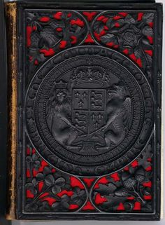 HUMPHREYS, Henry Noel The coinage of the British empire London: 1854 This is one of the black papier maché bindings which were supreme examples of Victorian Gothic and perhaps the biggest triumph among all the ingenuities of Victorian commercial bookbinding. They were manufactured by a patent process consisting of a mixture of papier maché and plaster composition, usually on a metal framework.