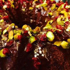Chocolate Bundt cake with pistachio and berries