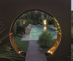Saint remy de Provence, Luberon -  contemporary moon gate frames entrance to pool
