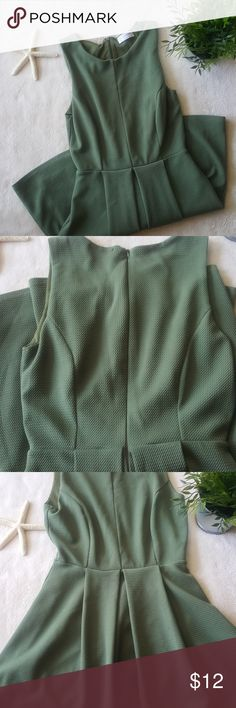 Olive green dress Cinched in at the waist. Zipper in the back. Material is strechy.  Perfect for work or an event! Purchased from a local boutique. Dresses