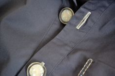 hand stitched buttonholes and handmade resin buttons of embroidered grey shirt dress by Minus Sun